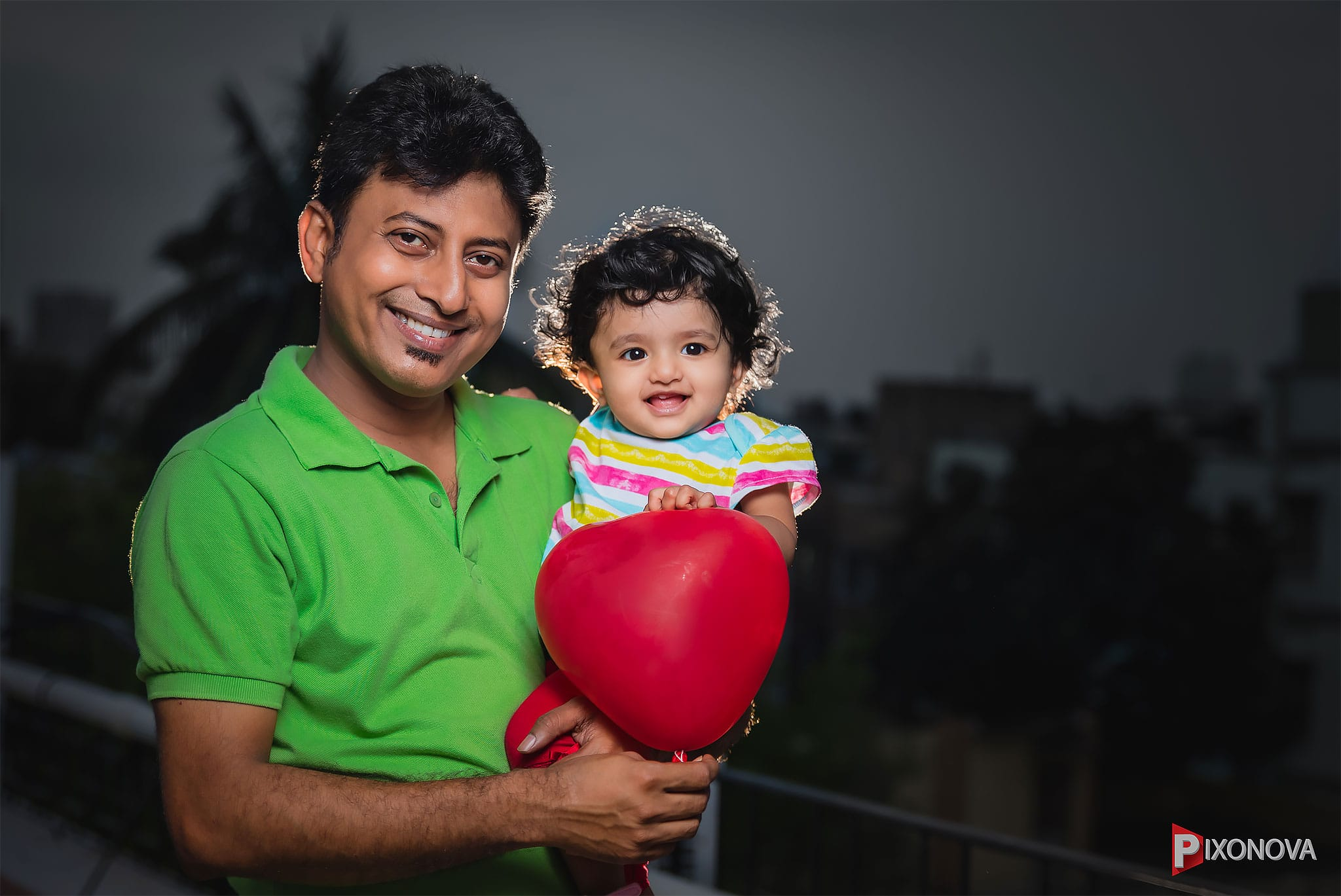 Sutirtha Sarkar with her baby smiling for the photo