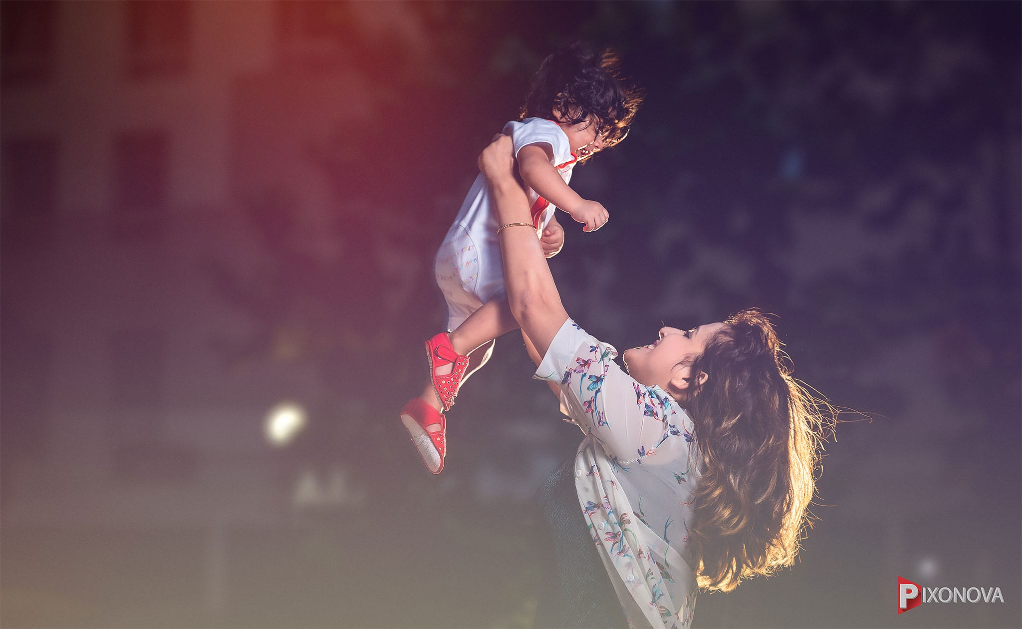 Mother play with her baby boy during a baby shoot