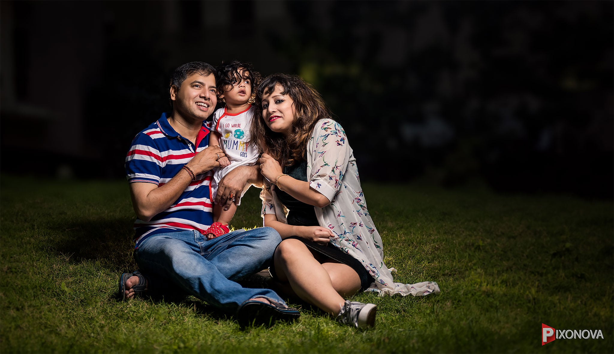 A complete family portrait sitting on grass shot by Rishav chakraborty Pixonova